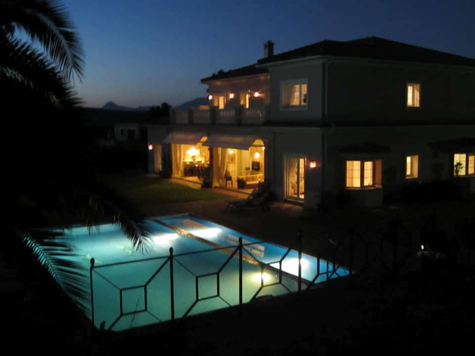 Conservatory, pool & terrace at night